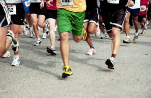 Legs of runners in a marathon.