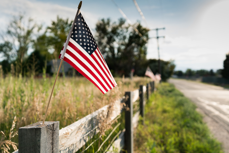 US flag on the wooden fence