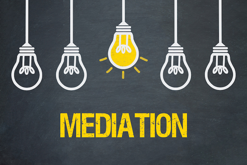 Mediation concept - lightbulbs on grey background.