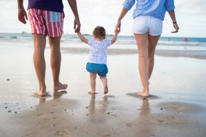 Parents with child at the beach.