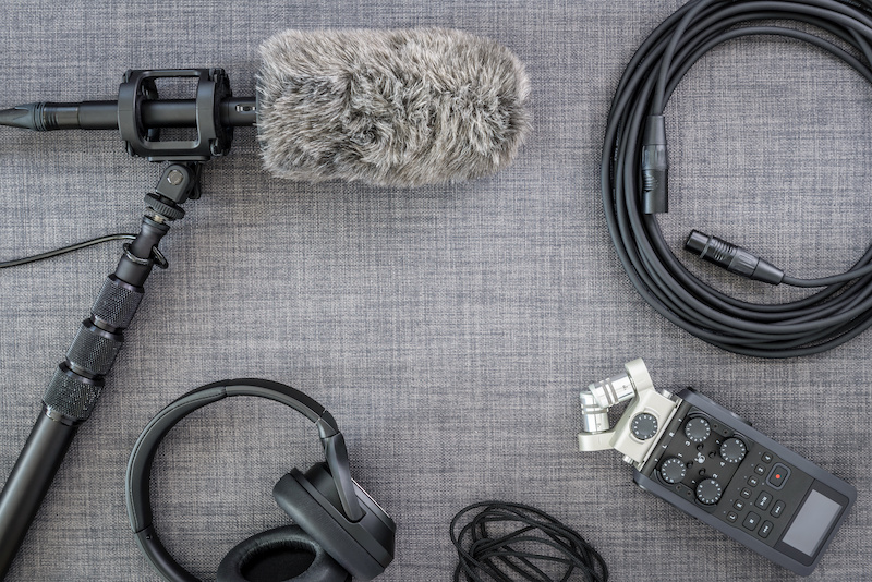 Overhead view of professional digital audio recording equipment and microphone.