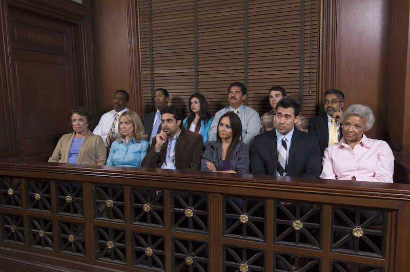 Jurors in the jury box, watching a case unfold.
