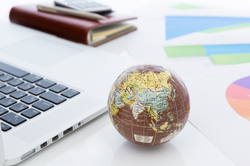 Small globe with laptop.