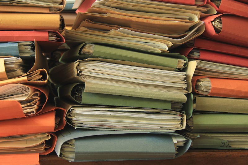 Stacked files in an office, old folders.
