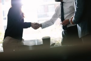 Business associates shaking hands after a deal in meeting. Business people hand shake and greeting each other after an agreement.