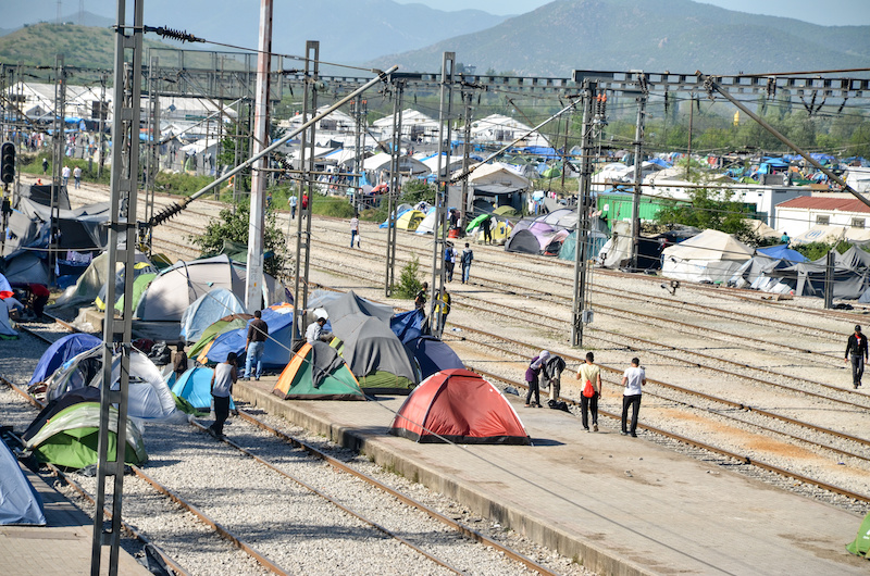 Living in a camp by a railroad, picture from Greece.