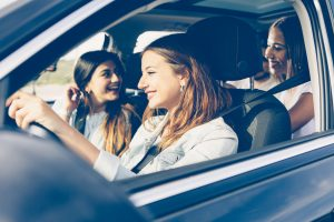 Group of girls friends traveling by car