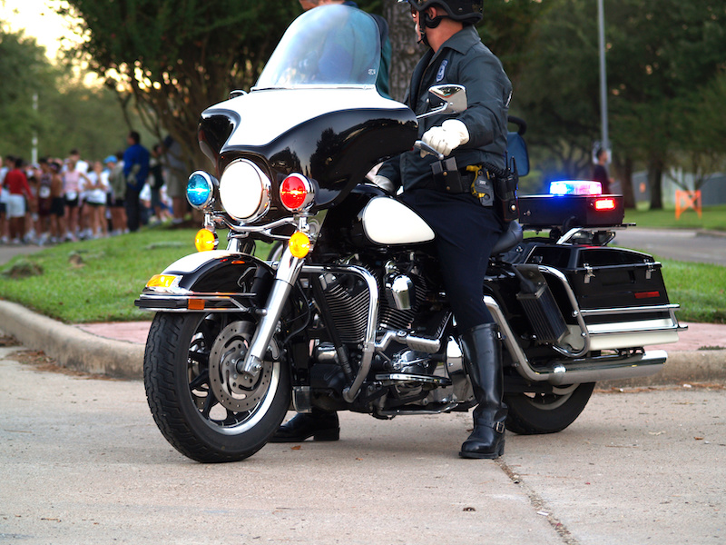 Police officer sitting on Motorcycle  - side view