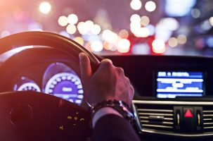 man driving a car at night