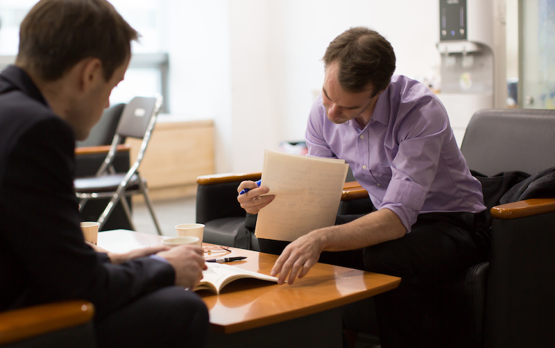 Two people going over a contract, meeting with attorney concept.