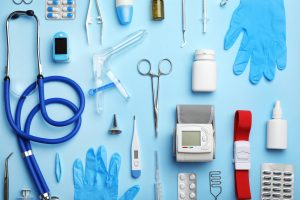 Medical Emergency Concept: Medical tools laying on a light blue background.