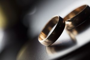 Divorce law concept, rings on a table.