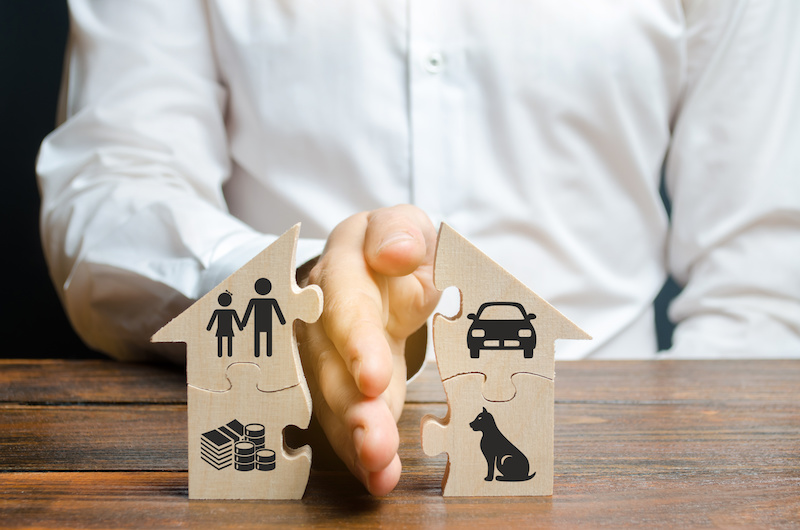 Divorce concept - a man dividing up the house and funds during a divorce.