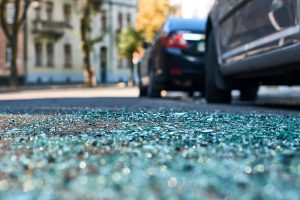 Sharp shards of car glass on the asphalt