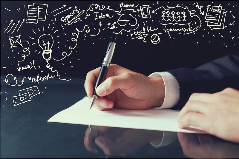 Lawyer writing a will example concept with hand on paper.