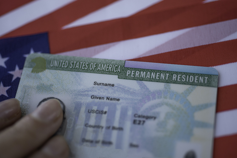 Permanent Resident Green card  of United states of America on flag of USA
