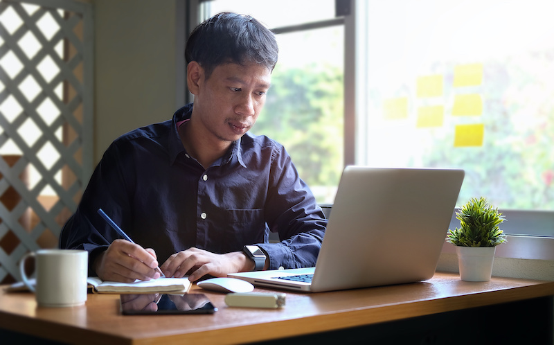 Man researching immigration topics at home.